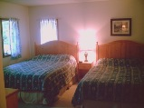 blue heron suite queen beds, effiency hotels parry sound, sunny point resort inn, ontario inn, places to stay in parry sound, parry sound inn