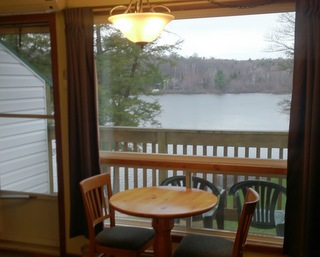 junior suite dining table with view of lake
