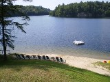 beach and pristine waters of otter lake, sunny point resort inn, waterfront inns parry sound