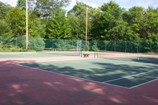 double tennis courts at sunny point resort, cottages and inn, otter lake resort, dogs allowed cottages ontario resorts vacations with pet friendly accommodations